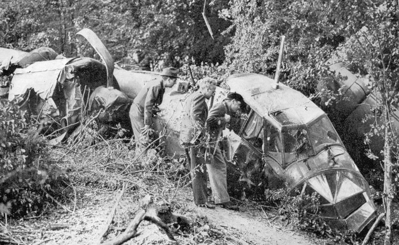 Do 17 U5+KA fuselage by the side of the Elham Valley Railway with Home-guardsmen inspecting the cockpit.