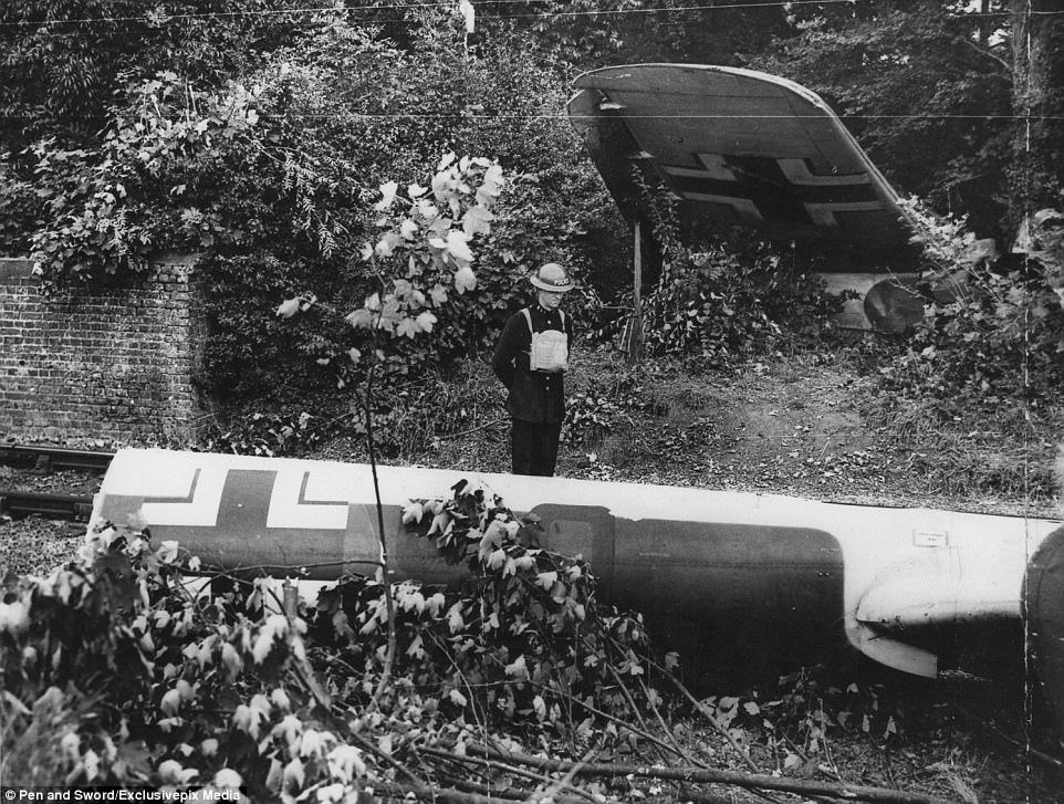 Do 17 U5+KA wing and tail by the side of the Elham Valley Railway guarded by Police Constable 88 of the Kent Constabulary.