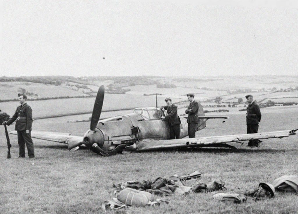 Bf 109 under guard after forced landing at Bladbean