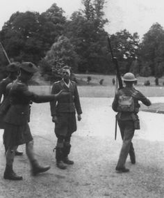 Lt. Böhm is escorted by the London Scots